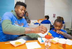 OKC Thunder player helps Positive Tomorrows student decorate cookies