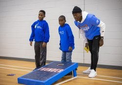 Positive Tomorrows students and OKC Thunder player playing games