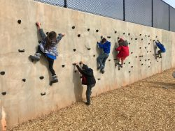 Positive Tomorrows students on the climbing wall