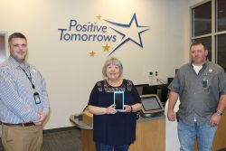 AT&T representatives and Positive Tomorrows' Susan Agel show donated mobile devices