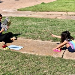 Positive Tomorrows teacher with student on sidewalk